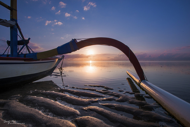Wide angle landscape featuring a boat at Sanur, Bali