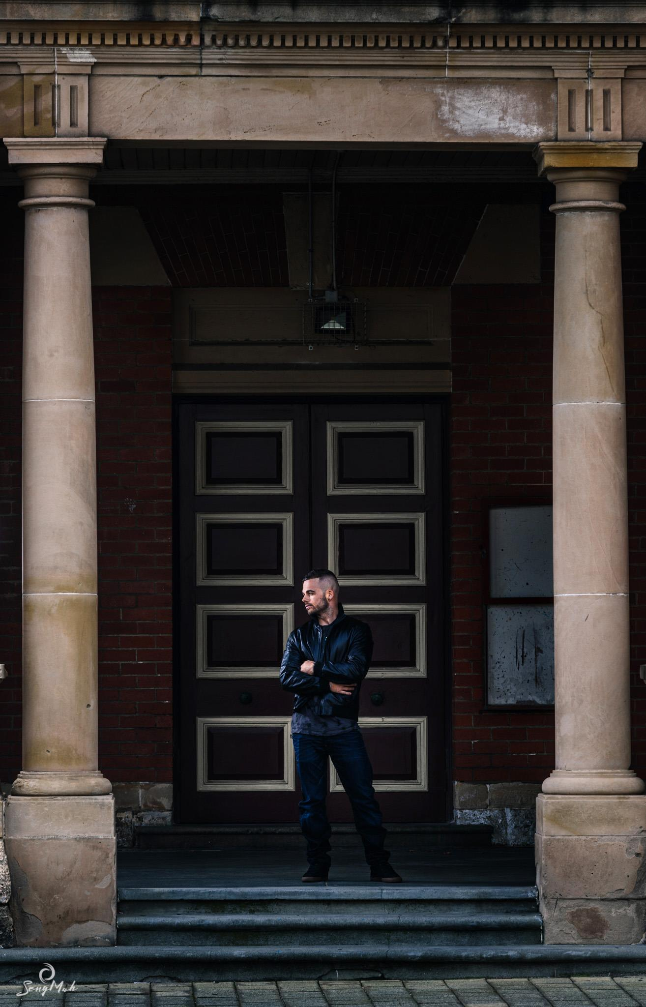 Man standing between columns