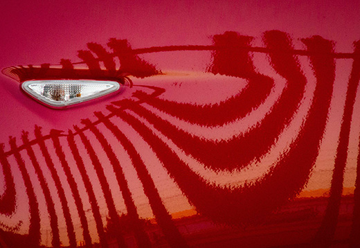Image of red car with reflections by Rhonda McInnes