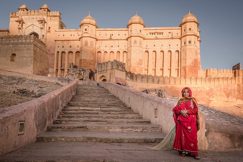 Amer fort worker in red sari
