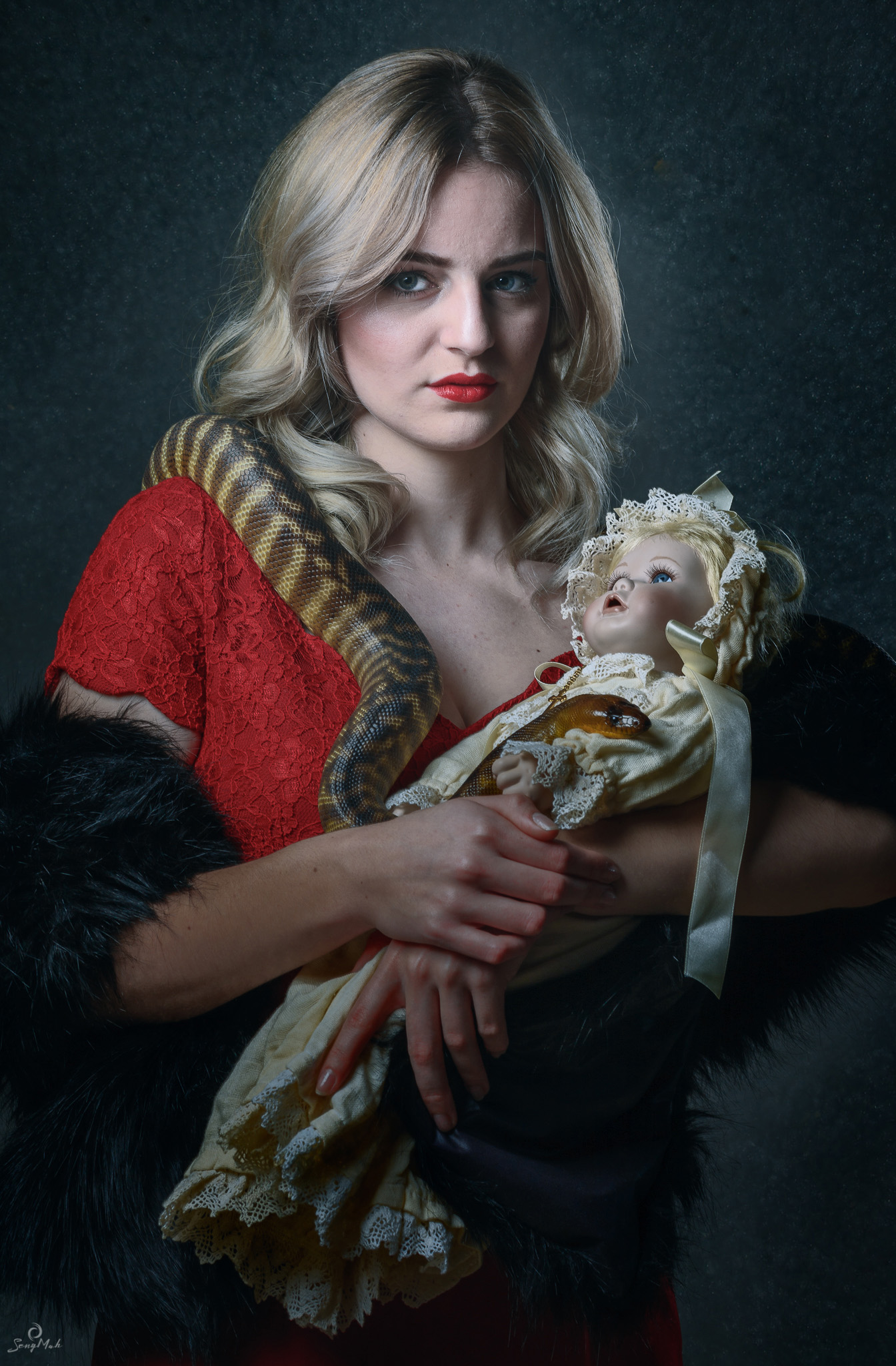 Young Woman with doll and snake