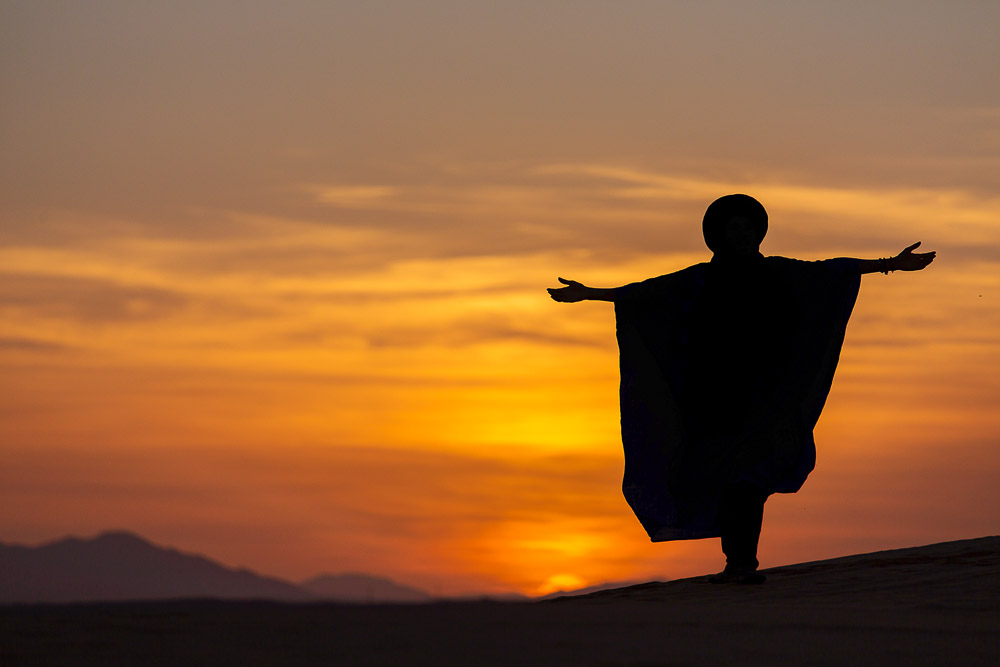 Silhouette of Berber at desert sunset