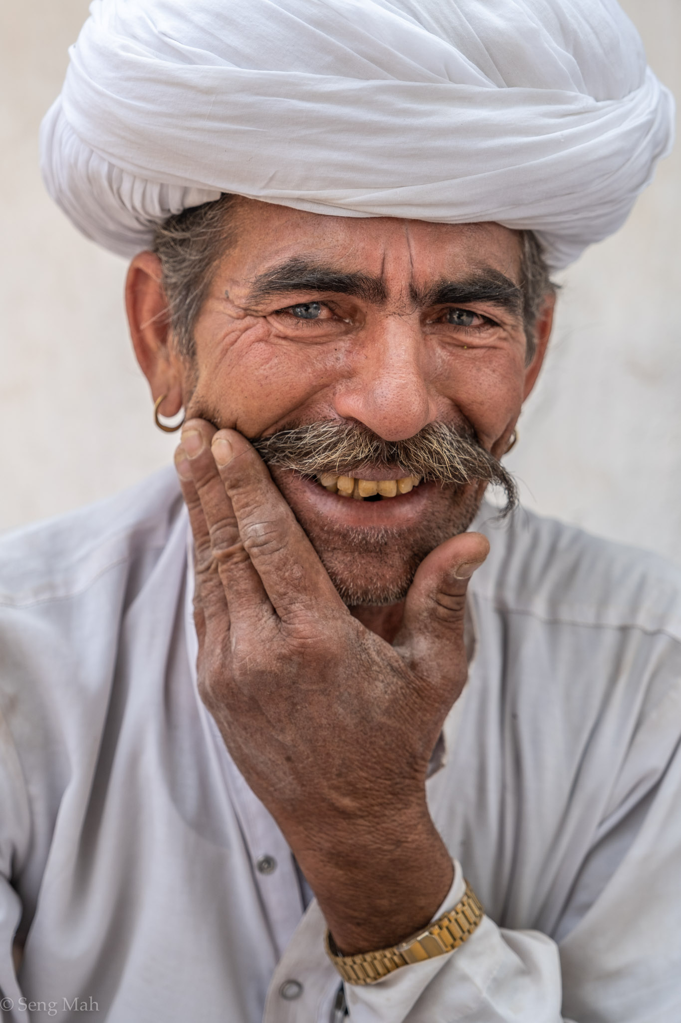 Portrait of a Rajasthani man in traditional white Bishnoi turban and kurta