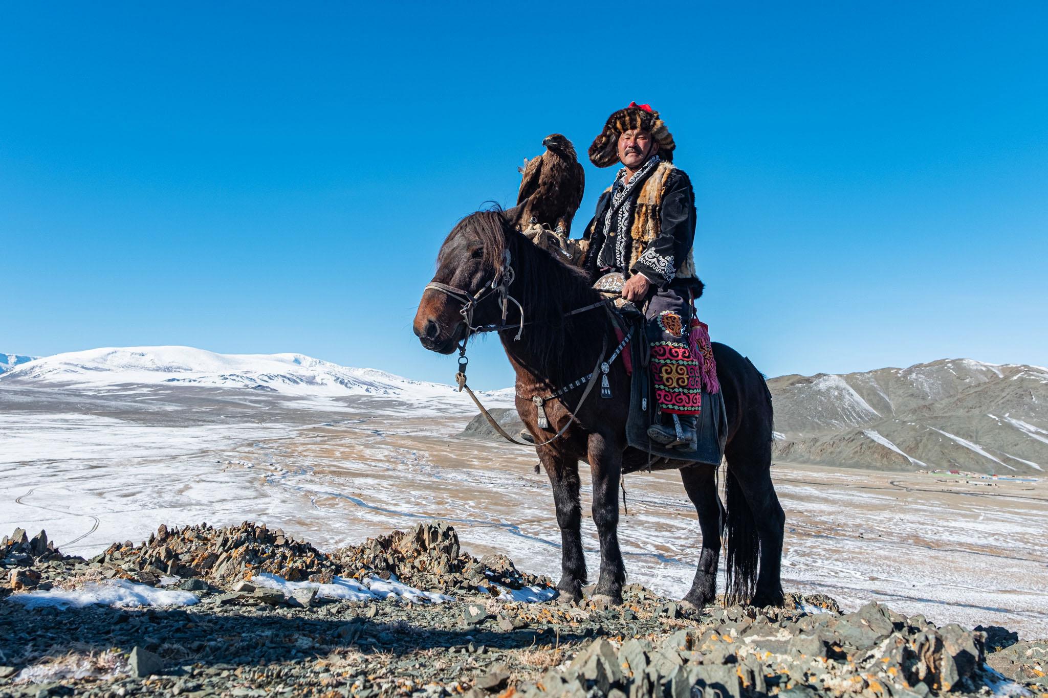Eagle hunter on mountain