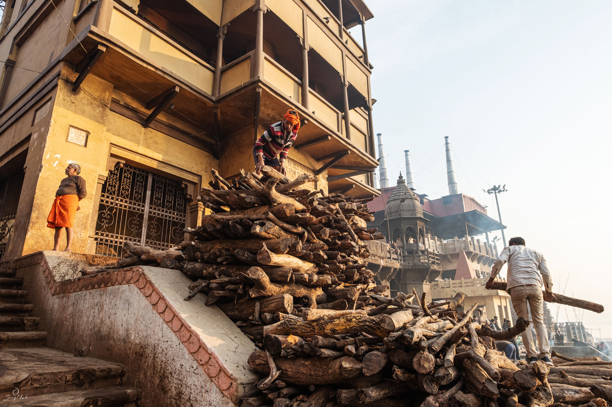 Piling cremation logs in Varanasi