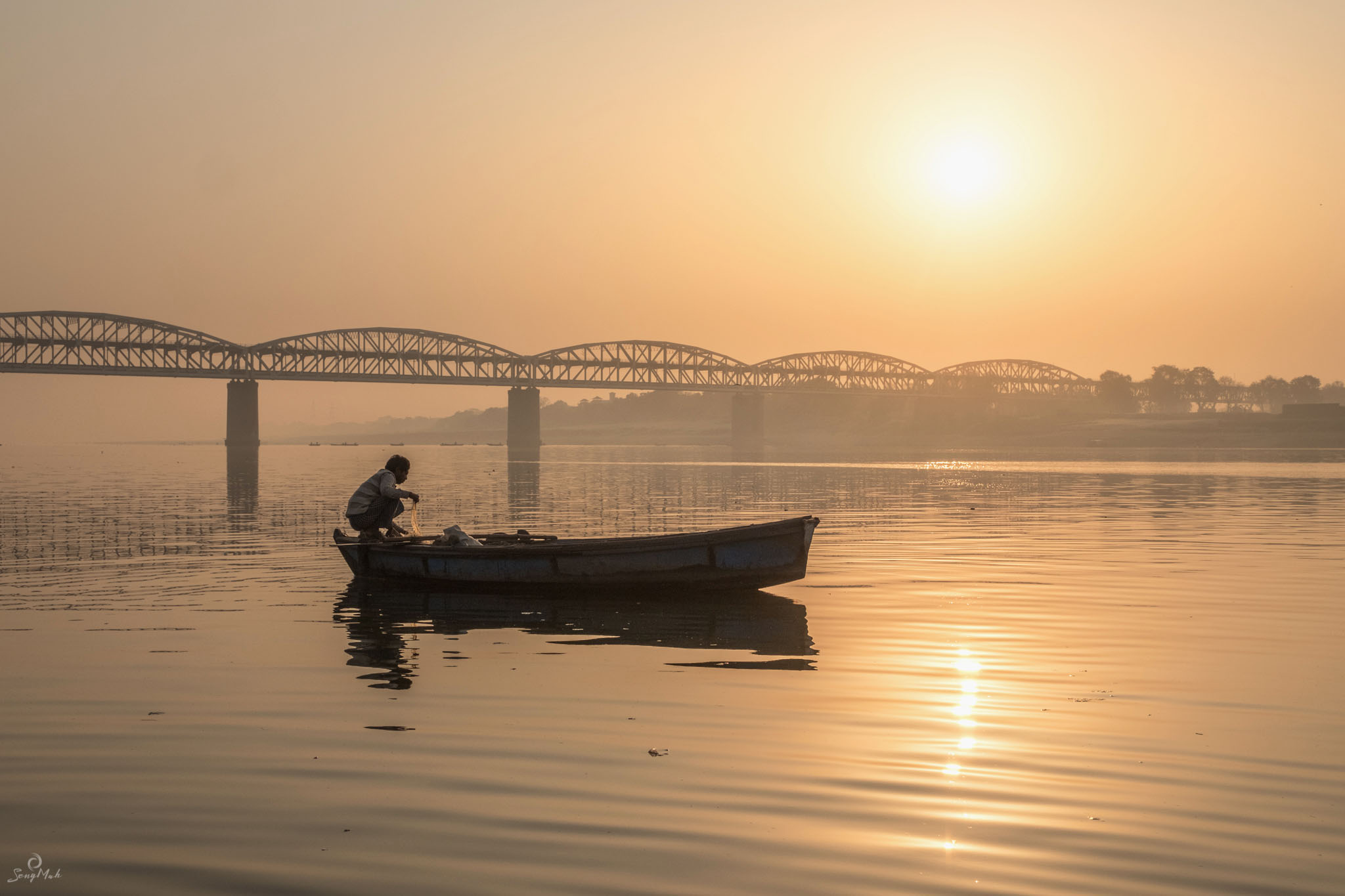 Sunrise over the railway bridge in Varanasi