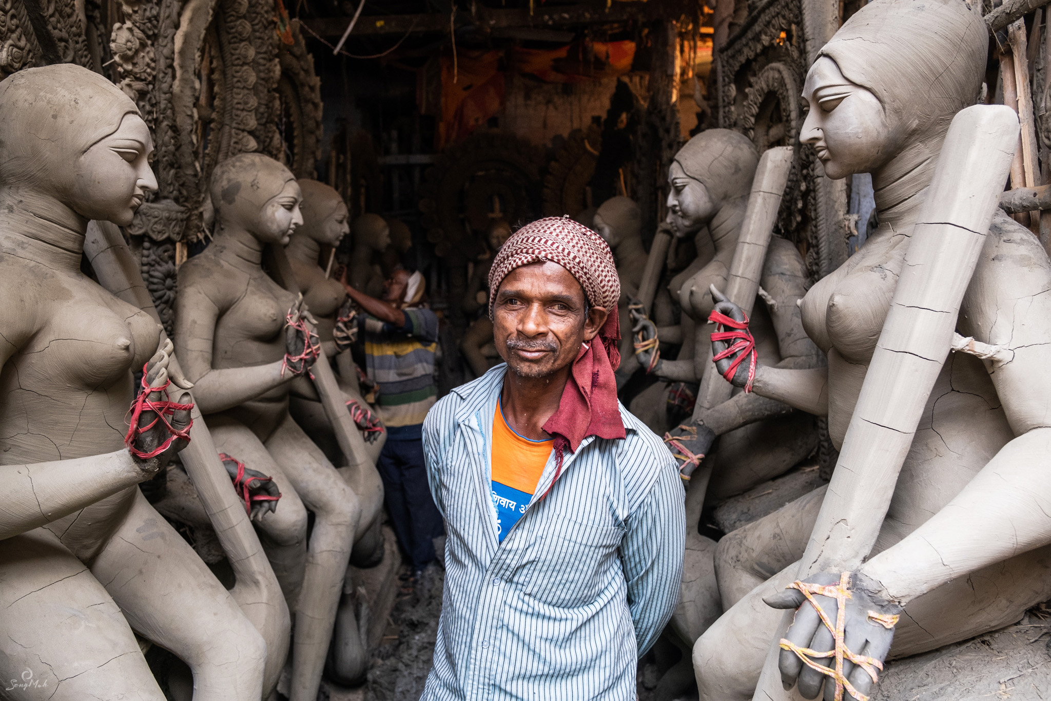 Clay sculptor in his shop