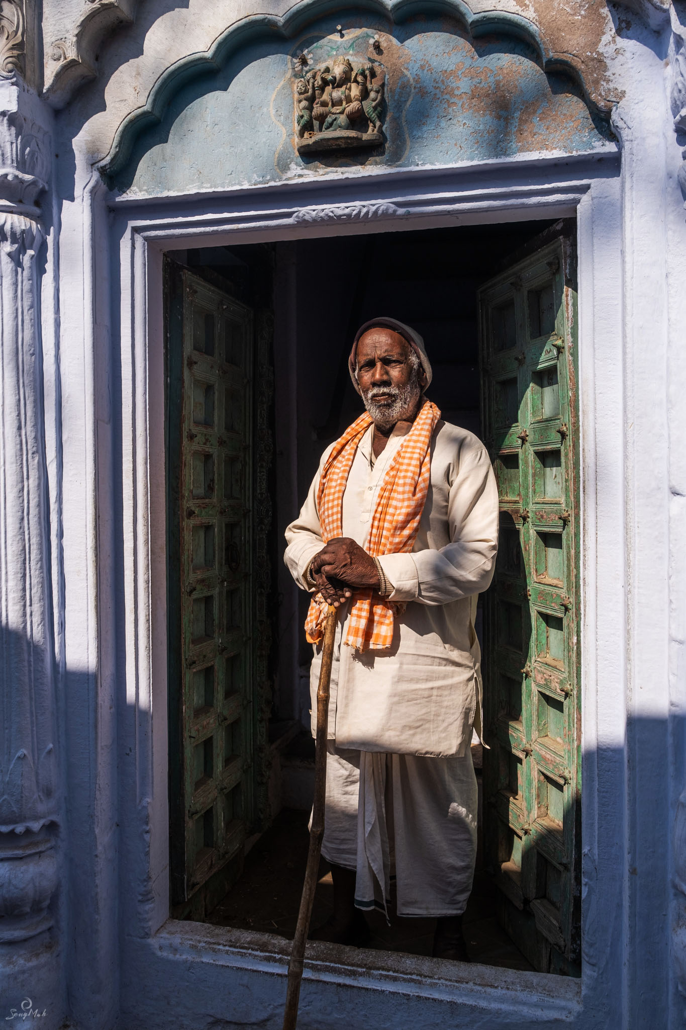 Man in doorway in Varanasi