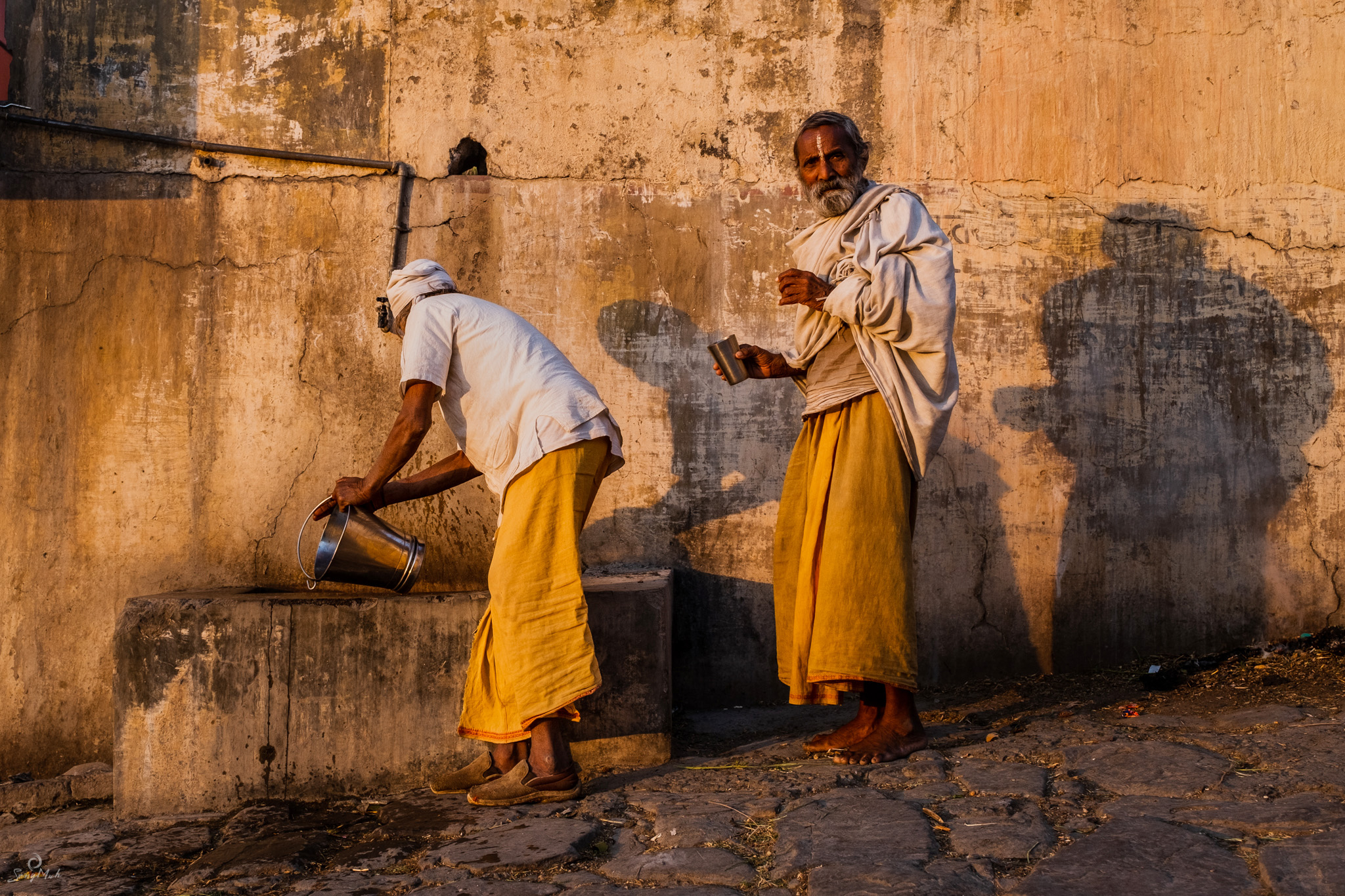 Sadhus at a water pump