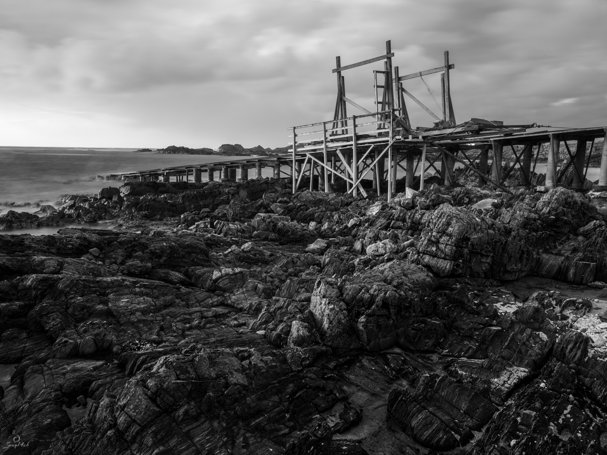 Black and White image of boat ramp on coast