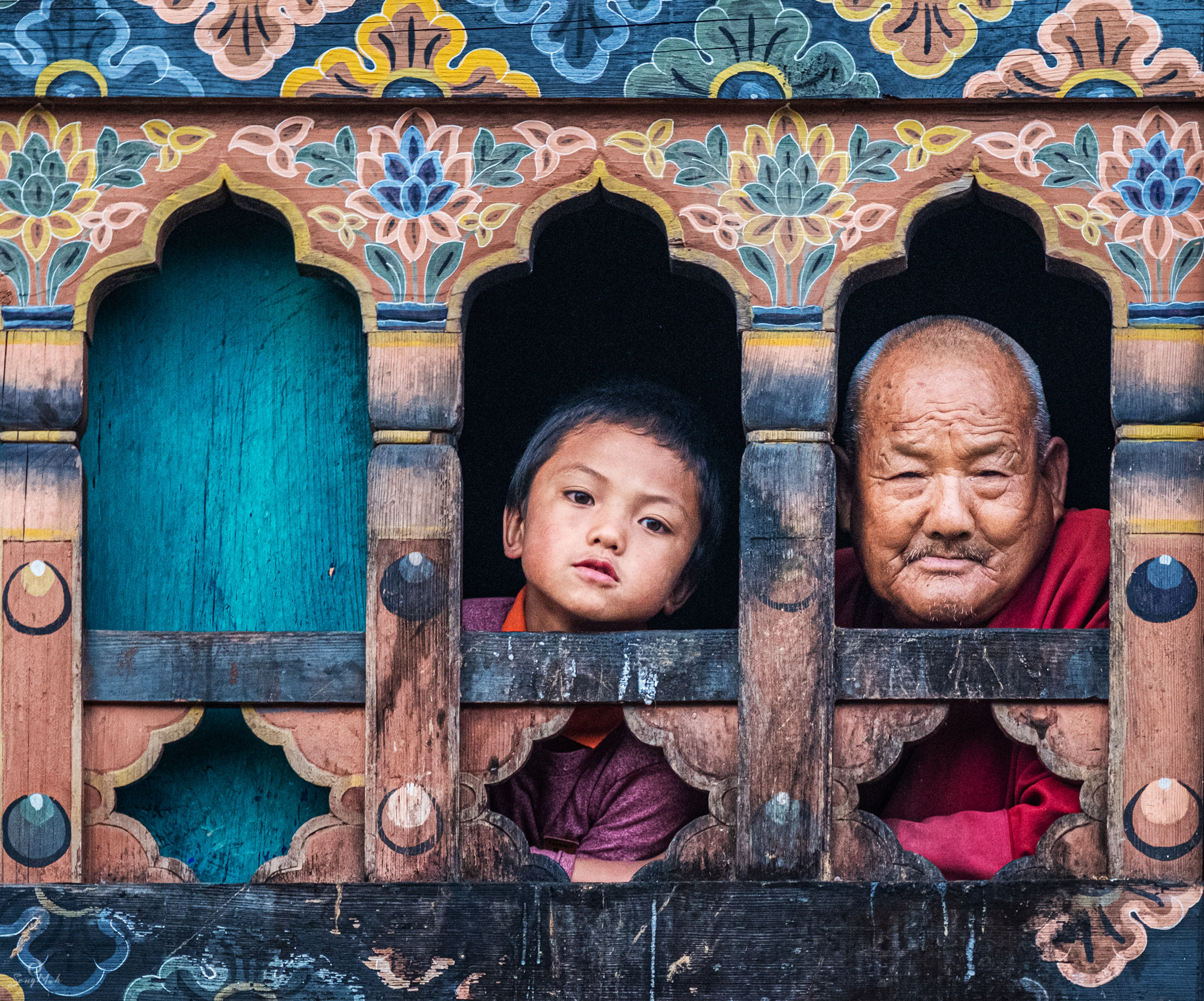 Bhutan - faces in a window