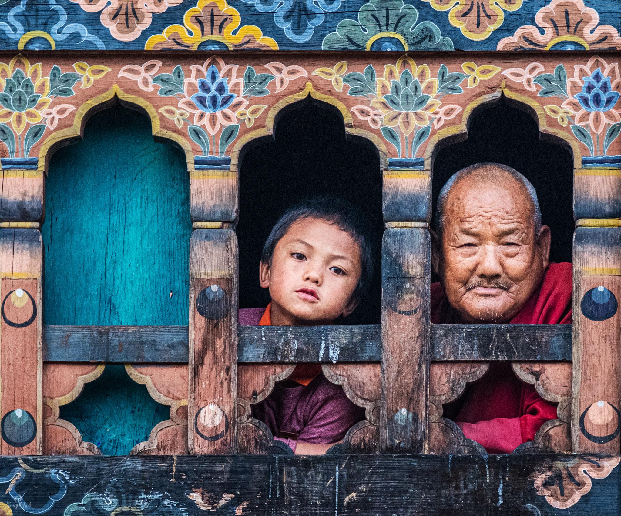 Bhutan - faces in a window