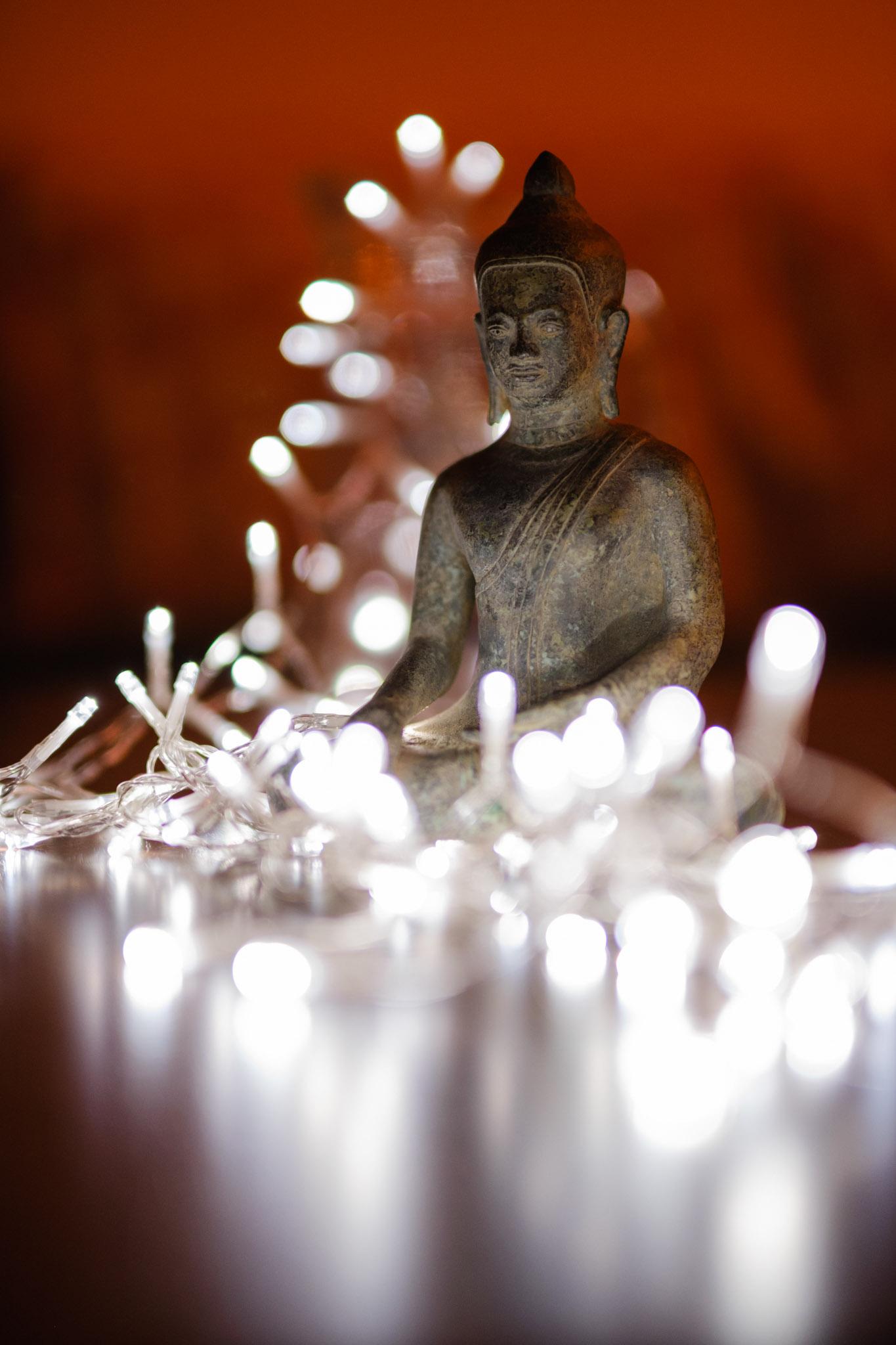 Buddha figurine with fairy lights