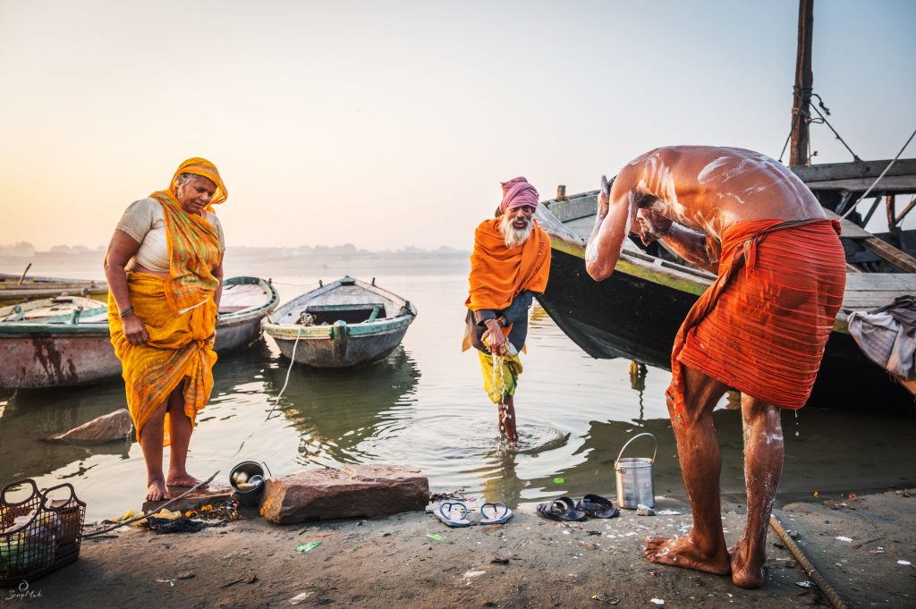 Morning bathers on the ghats in Varanasi, India.
